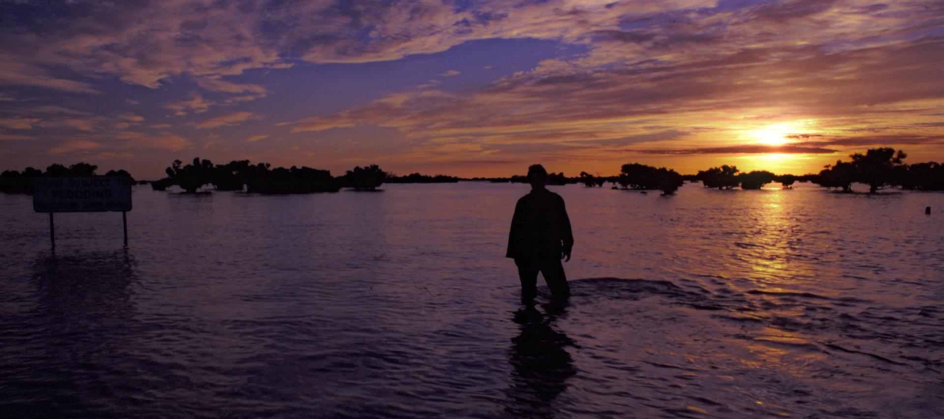 Standing in the flooded Cooper Creek, near Windorah, western Queensland.