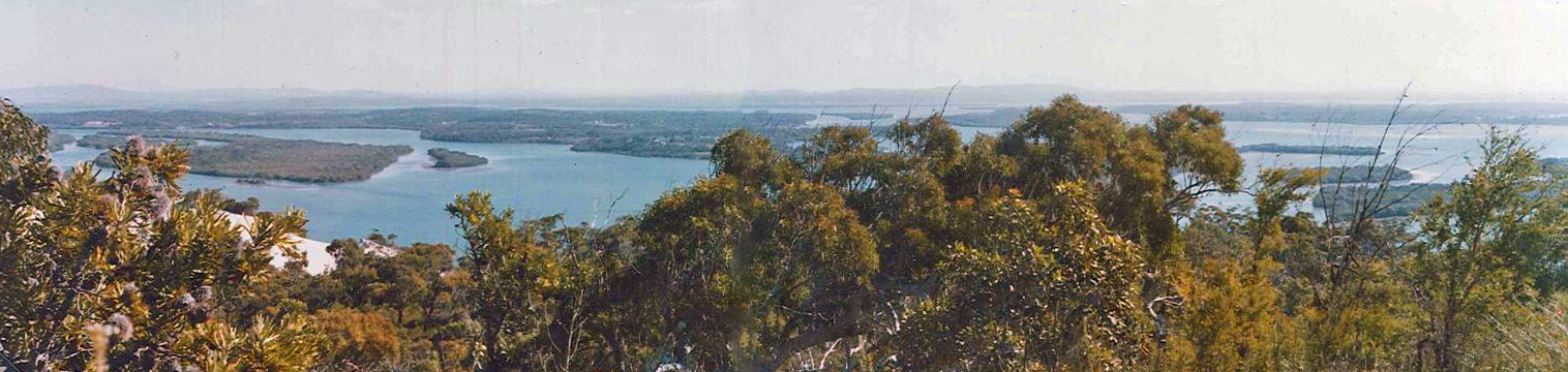 Looking south-east from North Stradbroke back to Lamb and Russell islands, and the distant Border Ranges, 1979.