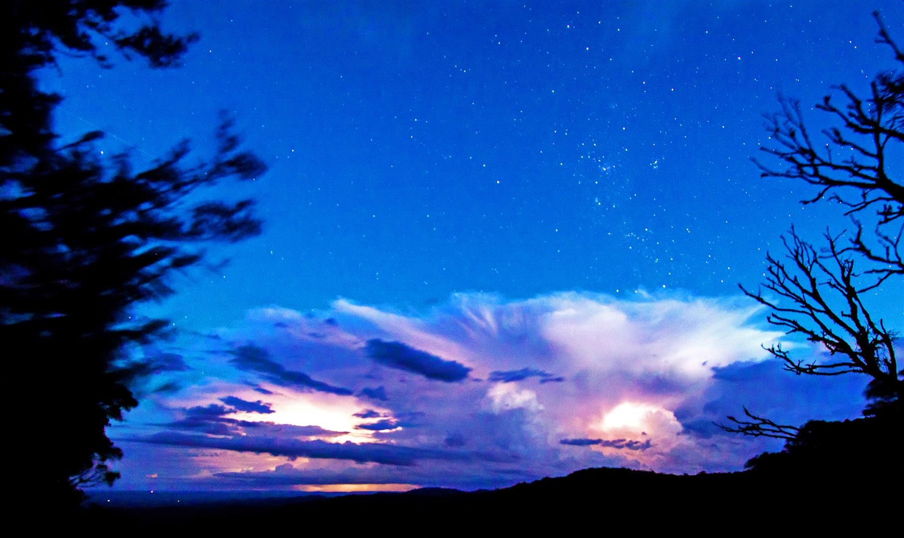A lightning-lit storm heads across the Bunya Mountains, driving insects and migratory needletails high into the air ahead of it. Photo Robert Ashdown.